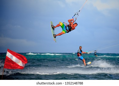 PHILIPPINES, BORACAY ISLAND, BULLABOG BEACH- January 01 2019: Athletic man performing acrobatic freestyle jump with kitebord. Wind related water sport