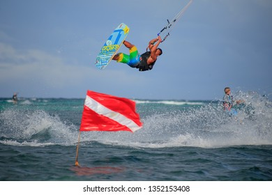 PHILIPPINES, BORACAY ISLAND, BULLABOG BEACH- January 01 2019: Sportive young asian man doing freestyle jump while kitesurfing. Extreme wave rider