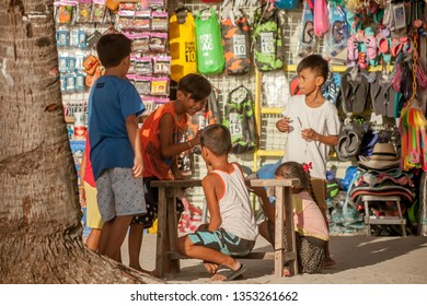 PHILIPPINES, BORACAY ISLAND, D-MALL - January 01 2019: group of asian kids playing arm wrestling on beach market. Happy childhood on Boracay island