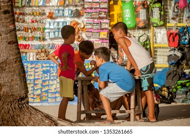 PHILIPPINES, BORACAY ISLAND, D-MALL - January 01 2019: group of asian kids playing a game on street market