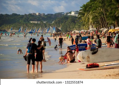 PHILIPPINES, BORACAY ISLAND - January 01 2019: Scene of beachlife at White Beach, sup boards, sail boats, a lots of turists. Travel to east Asia.