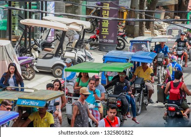 PHILIPPINES, BORACAY ISLAND - January 01 2019: traffic jam on east asian street with tuc tucs, eloctrocars, bikes and tricycles. Tourism and travel