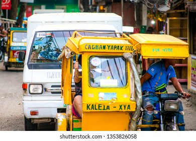 PHILIPPINES, BORACAY ISLAND- January 1, 2019: taxi tricycle moving in traffic on philippine city street. Asian transport