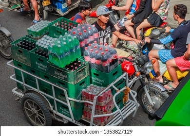 PHILIPPINES, BORACAY ISLAND- January 1, 2019: delivery of fizzy drinks packs in tricycle. Asian transport