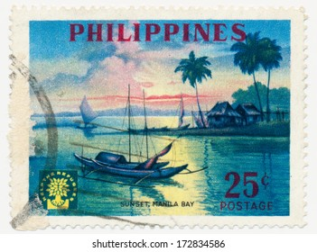 PHILIPPINES - CIRCA 1960: A stamp printed in Philippines, shows Sunset at Manila Bay and Uprooted Oak Emblem, circa 1960