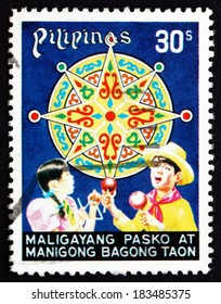 PHILIPPINES - CIRCA 1977: a stamp printed in Philippines shows Children Celebrating and Star from Lantern, Christmas, circa 1977