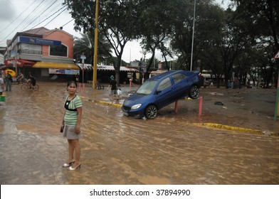 PHILIPPINES – CIRCA SEPT 2009:A car is left useless at Marikina street circa Sept 2009 in the Philippines. Typhoon Ondoy left hundreds of thousand families displaced and killed hundreds of people