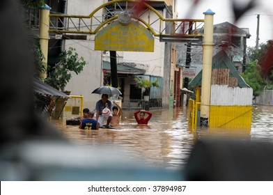 PHILIPPINES – CIRCA SEPT 2009:A group of people swim at Karangalan village circa Sept 2009 in the Philippines. Typhoon Ondoy left hundreds of thousand families displaced and killed hundreds of people