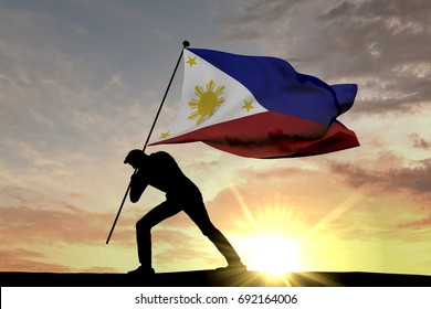 Philippines flag being pushed into the ground by a male silhouette. 3D Rendering