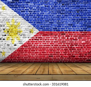 Philippines flag painted on brick wall with wooden floor