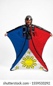 Philippines flag travel. Bird Men in wing suit flag. Sky diving men in parashute. Patriotism, men and flag.