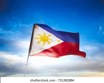 Philippines flag waving with pride on a sunny day / high contrast image