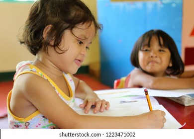 PHILIPPINES - JULY 22, 2018:  Filipino children happy to be learning at school and relaxing after their classes