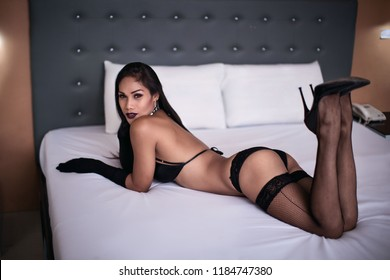 Philippines Ladyboy, transgender, dominatrix concept series in Latex fashion high heels and stockings