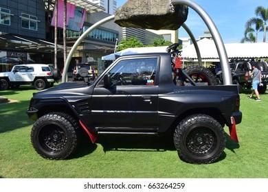 "Philippines, metro Manila, Bonifacio city 18.06. 2017: Sunday exhibition and advertising company. Cars prepared for off-road company ""Black Rhino""."