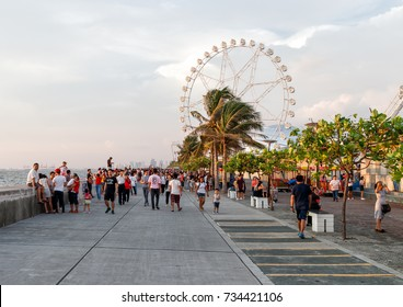 Philippines, Metro Manila, Pasay, 28 August 2017 - People Walking Around at SM Mall of Asia Bay Area