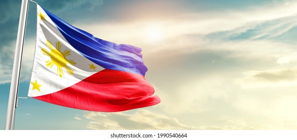 Philippines national flag waving in beautiful sunlight.