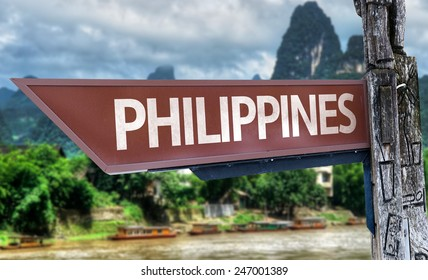 Philippines wooden sign with exotic background