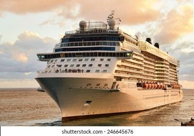 PHILIPSBURG - DECEMBER 24: Celebrity Reflection leaves the Caribbean port of Philipsburg Saint Maarten after a day long visit on December 24, 2014. it is a popular cruise destination.