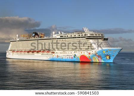 PHILIPSBURG, SAINT MAARTEN - JANUARY 21, 2017: The Norwegian Breakaway cruise ship is entering the port in Philipsburg, St. Maarten. This large colorful ship is part of the Norwegian Cruise Line.