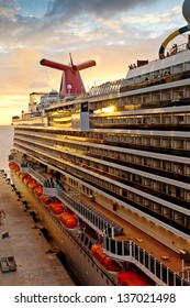 PHILIPSBURG, ST. MAARTEN - JAN. 16:  Carnival's Dream ship gets ready for departure at sunset on Jan. 16, 2013.  The ship is one of Carnival's largest ships, one of three in the line of Dream-classes.