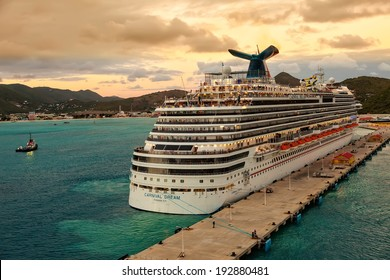 PHILIPSBURG, ST. MAARTEN - JAN. 16, 2013:  Carnival's Dream ship gets ready for departure from at sunset.  The ship is one of Carnival's largest ships, one of three in the line of Dream-classes.