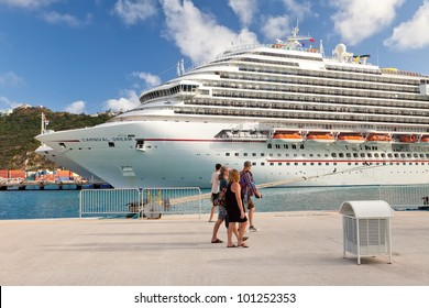 PHILIPSBURG, ST. MAARTEN - Jan 19:  Cruise passengers proceed to board cruise ship after spending a day in the port of St. Maarten, a popular destination in the Eastern Caribbean, on Jan. 19, 2011.