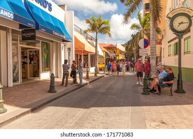 PHILIPSBURG, ST. MAARTEN - JAN.19:  Tourists shop along Front Street, the busiest street in Philipsburg for souvenirs on Jan. 19, 2011. Most visitors are cruise passengers, only in port for the day.