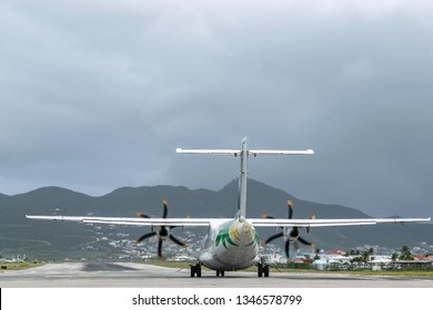 Philipsburg, St Maarten - November 16, 2018: Air Antilles medium twin turbo-prop regional aircraft (ATR 42-500) on runway at SXM (Princess Juliana International Airport) in Sint Maarten