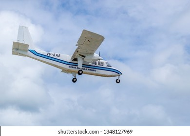 Philipsburg, St Maarten - November 16, 2018: Trans Anguilla Airways VP-AAA, a Britten-Norman BN-2A-21 Islander aircraft, landing at XSM (Princess Juliana International Airport) in Sint Maarten