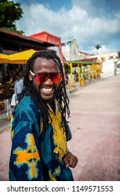 PHILLIPSBURG, ST. MAARTEN - JULY 11 - A friendly local guy with dreadlocks and colorful clothing on July 11 2018 in Phillipsburg, St. Marteen.