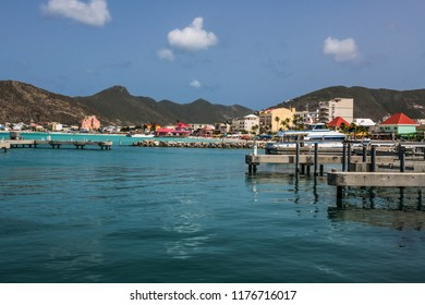 PHILLIPSBURG, ST. MAARTEN - JULY 11 - A scenic look at a marina with beach, hotels and mountains off in the distance on July 11 2018 in St Maarten.