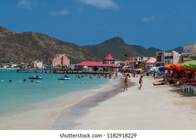 PHILLIPSBURG, ST. MAARTEN - JULY 11 - A scenic view of the beach and landscape and boardwalk buildings on July 11 2018 in Phillipsburg, St. Maarten.
