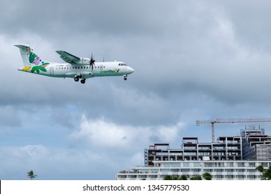 Phillipsburg, St Maarten - November 16, 2018: Air Antilles medium twin turbo-prop regional aircraft (ATR 42-500) F-OIXH preparing to land at SXM (Princess Juliana International Airport) Sint Maarten