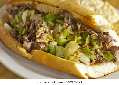 Philly Cheesesteak with diced onions peppers and mushrooms with tortilla chips and salsa on the side
