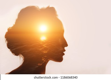 Philosophy concept. Sunrise and woman silhouette.
