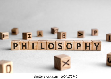 Philosophy - words from wooden blocks with letters, love of wisdom philosophy concept, white background