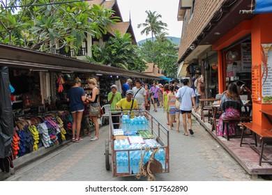 PHI-PHI ISLAND,  THAILAND - NOVEMBER 29, 2013: lot Tourists shop at the old town market walking street. Koh Phi Phi Don in andaman sea, Phuket, Krabi, South of Thailand.