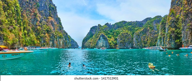 PHIPHI LEH, THAILAND - APRIL 27, 2019: Panorama of picturesque Pileh Bay, surrounded by tall rocks of Phi Phi Leh Island, covered with greenery, on April 27 in PhiPhi Leh