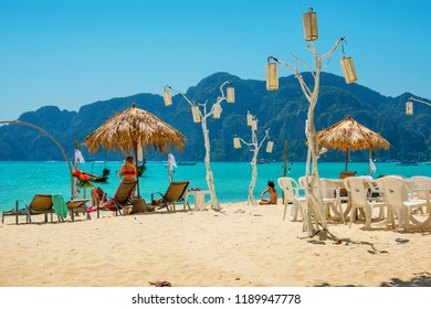 PHI-PHI, THAILAND - FEB 09, 2015:  People relax on sandy beach in February 2015 Despite holiday season, there is still not very crowded places on beach
