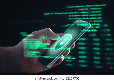 Phishing, cyber security, online information breach or identity theft crime concept. Hacked phone. Hacker and cellphone with hologram data. Mobile scam, fraud or crime. Cybersecurity infringement.