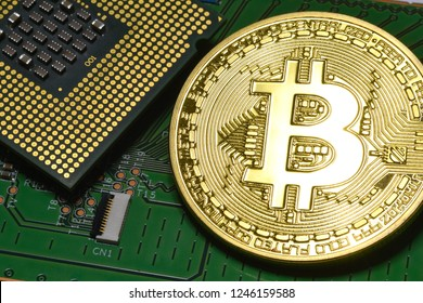 phisical gold bitcoin over electronic circuit and cpu processor