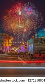 Phitsanulok Province,Thailand -1 January 2019  Firework for celebration on time Happy new year festival in Thailand and cityscape ,business zone in middle town