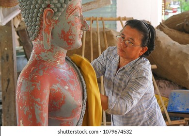 Phitsanulok, Thailand - 8 Apr 2012: The women are cleaning the buddha sculpture at foundry buddha statue factory