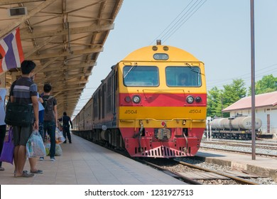 Phitsanulok, Thailand - Apr 09 2018: State Railway of Thailand Diesel electric locomotive 4504 hauls a train in Phitsanulok Railway station, Phitsanulok, Thailand.