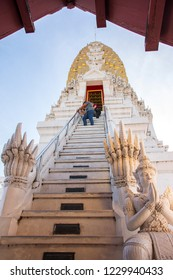 Phitsanulok, THAILAND - April 09, 2018: Visitor are climbing up to pagoda in Wat Phra Sri Rattana Mahathat Temple, Name is Phra Buddha Chinnarat, Phitsanulok in Thailand.