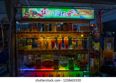 PHITSANULOK, THAILAND - DECEMBER 15, 2018: mixed fruits in plastic cups, for sale, for making fresh fruit juice  at night of Phitsanulok province, Thailand