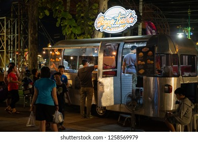 PHITSANULOK, THAILAND - DECEMBER 15, 2018:The burger trailer in front at night of Phitsanulok province, Thailand