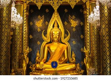 Phitsanulok, THAILAND - FEBRUARY 23, 2021: The Golden Buddha Statue in Phitsanulok Province ,Wat Phra Sri Rattana Mahathat Temple, Name is Phra Buddha Chinnarat, Phitsanulok in Thailand.