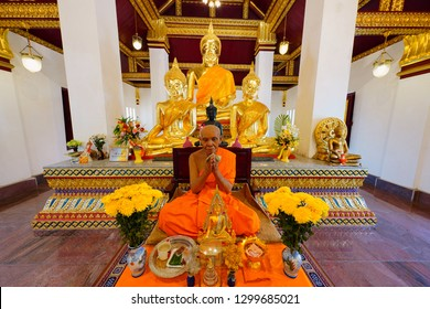 Phitsanulok, Thailand - January 30, 2019 : Group of Buddha statues and Buddhist priest wax model in sanctuary at Wat Phra Si Rattana Mahathat, Phitsanulok, Thailand